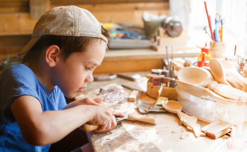 boy learning wood carving